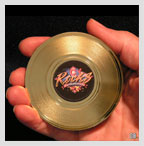 hand holding mini gold record magnet